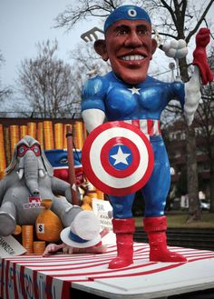 A carnival float featuring US President Barack Obama parades in the street of Cologne, western Germany during the traditional carnival parade of the so-called Rosenmontag (Roses Day) on February 20, 2012.