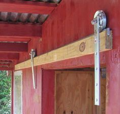 5 Acres & A Dream: A Barn Door for the Chicken Coop A GENIUSLY CHEAP way to make a barn door track! All the hardware together may cost abt $20!