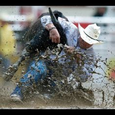 Matt Reeves PRCA Steer Wrestler. Getting it done in the mud!