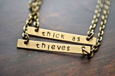 "These ""thick as thieves"" necklaces. 