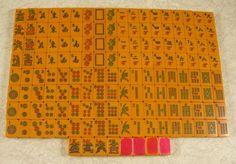 Vintage CORONET Bakelite Mah Jong set in rich deep orange, 152 tiles. Note: Smoking Dragons