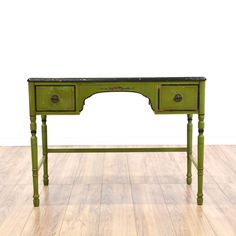This cottage chic desk is featured in a solid wood with a distressed antiqued green finish. This writing desk has 2 drawers, floral painted accents and delicate carved legs. Perfect for a small home office area! #cottagechic #desks #writingdesk #sandiegovintage #vintagefurniture