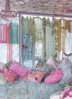 Betsy Johnson's apartment from a few years ago. Clothes as curtains...i've done that before...