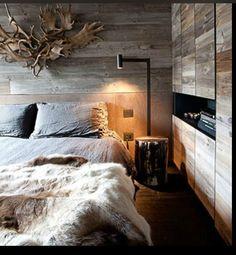 Mountain home retreat. Fur throw, linen bedding, reclaimed wood, antler decor.