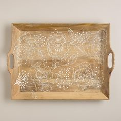 Crafted in India, our exclusive Fortress Bouquet Wood Serving Tray features intricate floral artwork with painted details against a rustic wood base. >> #WorldMarket Mother's Day