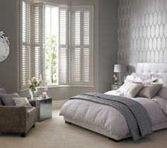 Oh yes! I would love waking up to these full length shutters on a summers morning... and a winters morning... Such a beautiful efect with the light in this Bedroom.