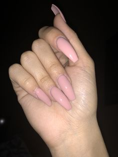 Long coffin pink acrylic nails.