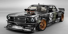 Take a 1965 Ford Mustang, Add a Roush Yates 410 cubic inch Ford V8. Add a six-speed transmission. Add all-wheel drive. Add paint and bodywork that make it downright terrifying to look at. You get The Hoonicorn, Ken Block's ride of choice for the seventh installation of his Gymkhana insanity-fest.