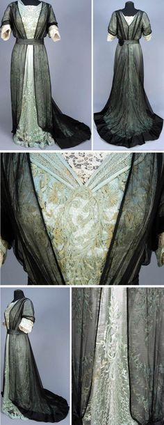 Evening gown ca. 1908. One-piece celadon floral embroidered net over satin. Bodice and short sleeves trimmed with cream-colored needle lace. All layered under black chiffon, open at front. Pleated sash with black satin medallion and satin hem band. Whitaker Auctions