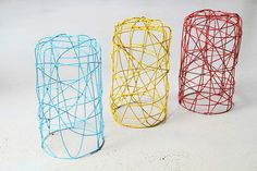 Wire stools in blue, yellow and red colours