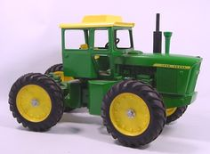 Ertl-JD-7520.Have this  1/16th John Deere 7520 from early  1970s