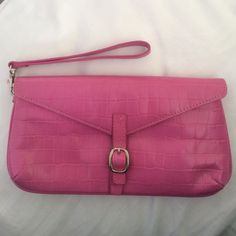 LOFT Pink Wristlet/Clutch Wristlet strap is fully detachable, so can be used as a wristlet or a clutch. Only used a few times. Outside of wristlet is in great condition. Both inside compartments have some marks/stains on lining. There is also a compartment in the back to keep phone, etc. About 9.5 inches long and 5.25 inches tall. Magnetic close. LOFT Bags Clutches & Wristlets