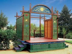 Custom made outdoor children's theater stage. This inspired me to have something similar made for my kids during their pre-teen musical stage. Now we use it to show movies in the backyard! Later it will be filled with rugs and outdoor furniture and lots and lots of pillows (and books!)