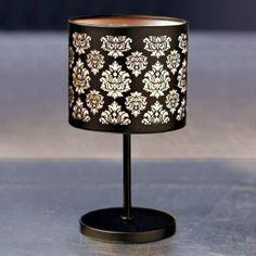 "Forbidden Boudoir Candle Lamp -Set a romantic mood with the captivating sparkle of our midnight-hued lamp. A votive or tealight, sold separately, shimmers seductively through intricately-cut metal. Includes glass votive cup. 7¾""h, 4¼""dia. #CENTERPIECE #PARTYLITE #CANDLES #BEDROOM #HOMEDECOR p91424 http://www.partylite.biz/legacy/sites/nikkihendrix/productcatalog?page=productdetail&sku=P91424"
