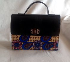 Pretty and sophisticated. Black with multi color Ankara print handbag. Blue, black multi. Women's fashion. Women's purses. Contact to order. Delivery available.