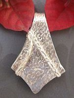 http://www.aromapendants.com.au/products/002-02.jpg. Made by Julie Primmer