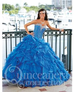 Quinceanera Dress #26757 Quinceanera ball gown, strapless sweetheart corset/organza, heavily beaded, full skirt with cascading organza ruffles, lace up back. Organza