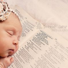 Baby with a book ... bible verse, baby name book with their name, children's story... lots of ideas.