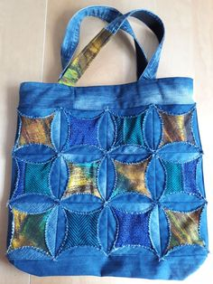 Ulla s quilt world quilted pouch and bag cathedral window quilt bag – Artofit Patchwork Bags, Quilted Bag, Blue Jean Quilts, Shabby Chic Quilts, Diy Bags Purses, Denim Purse, Denim Crafts, Denim And Lace, Recycled Denim