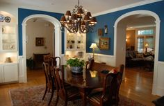 Blue Wall Paint Also Contemporary Oval Dining Table Plus Carved Wood Chairs And Attractive Chandelier