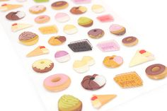 If you're into the popular Iwako novelty erasers, you'll love these gel stickers! These adorable and glossy stickers feature yummy baked goods.