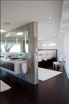 Master bedroom/bathroom. Love the idea of a wall to seperate instead of 2 completely seperate rooms!