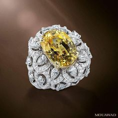 Mouawad's exquisite high jewelry rings elevate a classic style with a unique center stone. #MouawadHighJewelry #YellowSapphire #MouawadRings خاتم من مجموعة المجوهرات الفاخرة يشعّ بالألماس والزمرّد.