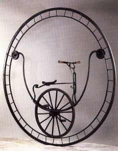 """""""In 1869 the craftsman Rousseau of Marseilles built this monocycle, which perches the cyclist on the inside of a 2 1/2 yards-high wheel. As there is no steering mechanism, it makes uncommon demands on the rider's sense of balance."""" (from Galbiati & Ciravegna)"""