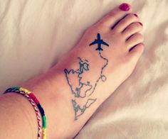 Wanderlust tattoo- i really like this, but not on the foot