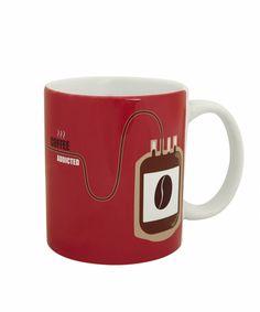 """Deze """"coffee addicted"""" mok is natuurlijk een """"must have"""" voor iedere koffieleut. De mokken zijn vaatwas bestendig."""