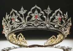 British Royal Jewels: The Oriental Circlet - 1853 made by Garrard designed by Prince Albert for Queen Victoria. Originally set with opals one of Albert's favorite stones; Queen Victoria left this set to the Crown in her will. Queen Consort Alexandra replaced the opals with rubies. Queen Consort Elizabeth wore the it frequently. Queen Elizabeth wore it at a state visit to Malta in 2005 and it hasn't been publicly since.