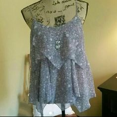 Women's flowy tank. Women's flowy tank.  Maurice s brand.  Size small.  Pretty lavender and pink colors.  Worn twice.  Less than 6 months old. Maurices Tops Tank Tops