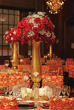 Roses and Baby's Breath topped centerpiece with hydrangeas and candles at base.