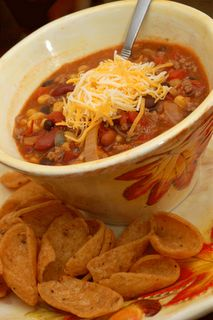 Taco Soup.  1 lb. ground beef (I use round)  1 onion, chopped  1 can chili beans  1 can black beans  1 can kidney beans  1 can corn, drained  1 can rotel  1 can diced tomatoes  1 pkg. taco seasoning  1 pkg. ranch dressing mix  2 to 4 cups water (add water until your desired consistency is reached)