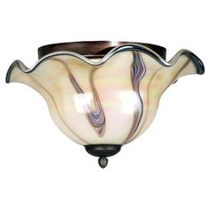 Cast a warm glow in your entryway or kitchen with this lovely metal flush mount, showcasing a swirling art glass shade and ruffled trim.