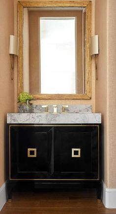 Chic gold and black powder room