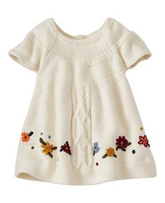 Supercrafted Nordic cableknit with a circular yoke, hand-embroidered flowers and easy fit. This cozy dress is sure to be the star of family photos for the holiday season—and lovingly Hanna-me-downed for many more to come.   <br>  •NEW baby/toddler sizes = a perfect fit for every little one<br> •Supersoft cotton/Merino wool yarns<br> •Textured cableknit<br> •Hand embroidery<br> •Circular yoke<br> •A-line silhouette<br>  •Raglan sleeves<br> •Machine wash...
