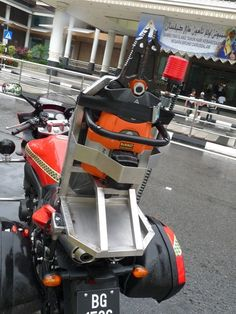The Holmatro BCT 3120 battery powered hydraulic cutter/spreader aboard the Brunei FRD 2010 Yamaha FZ6 Fazer S2 fire motorcycle (rescue mode)