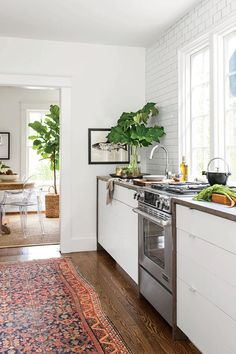 Solution - Bright White Bungalow - Southernliving. They reconfigured the rooms to form a spacious galley.