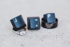 Fun ring shot with computer keys!! nerdy wedding | geek bride | unique wedding photos | rings | engagement rings | wedding photography Photos by Erin DeZago Photography