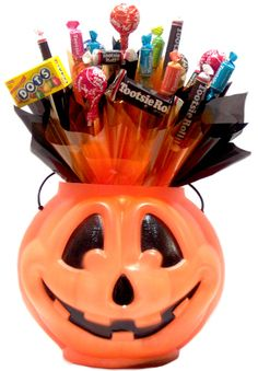 what if you taped each treat to a pencil? Cute for trick or treaters!