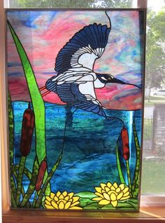 Night Heron Original by Stained Glass Heirlooms   About the Art Piece   Photos rarely capture the true brilliance of the colors and textures of art glass. At Stained Glass Heirlooms we strive to get g