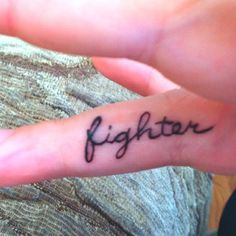 "maybe get ""lover"" on my left hand and then ""fighter"" on my right hand? :)"