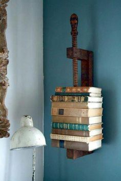 old rusted C clamp turned into a vertical book holder.