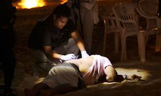 The body of a man killed by drugs hitmen in Acapulco.  Guatemala has joined other Latin American countries in calling for global regulation of drugs.