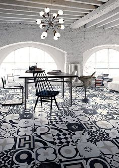 Black & white & patterned, this modern dining room has so much going for it. Mismatched tiles, white brick walls, & a starburst chandelier give this space an urban feel. Floor Design, Tile Design, House Design, Bathroom Floor Tiles, Tile Floor, Kitchen Floor, Interior Architecture, Interior And Exterior, Interior Decorating