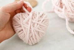 Make your heart feel all warm and fuzzy with these simple and easy Valentine Yarn Hearts. It's the perfect craft for the whole family! Crafts For Seniors, Fun Crafts For Kids, Crafts To Make, Crafty Projects, Projects To Try, Art Projects, Wine Glass Candle Holder, Rainbow Bubbles, Valentines Day Decorations