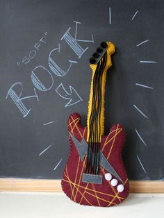 """How-To: """"Soft"""" Rock Guitar   MAKE: Craft going to enlarge this, alter the pattern slightly and make it into an over the shoulder backpack. Going to use boning inside the handle with a little quilt batting to make it stand up. Might make it out of denim."""