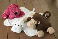 Kwik Sew Puppy Monkey Pillows and Blankets Pattern So, or should I say sew, cute an idea. Great for throwing on the livingroom floor for the toddler watching tv. Kwik Sew Patterns, Craft Patterns, Stuffed Animal Patterns, Diy Stuffed Animals, Sewing Toys, Free Sewing, Free Monkey, Fleece Crafts, Dog Blanket