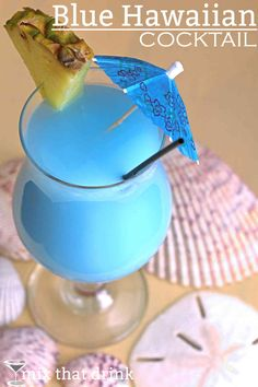 The Blue Hawaiian is similar to the Pina Colada, with rum, pineapple juice and cream of coconut - a little taste of tropical paradise. The big difference is the beautiful ocean blue color. Learn how to make one here!